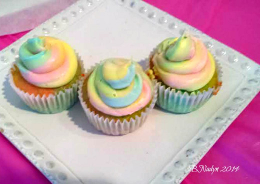 Make the cake batter and icing both rainbow-colored.  Keep reading for instructions and  more ideas for rainbow-colored food!