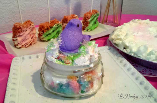 Rainbow cake in a jar: You can cook the rainbow cake right in the jar or after the cake is baked, place some in jar and top with icing and sprinkles.  For this cake, I just used cool whip topping and a marshmallow Peep for Easter.