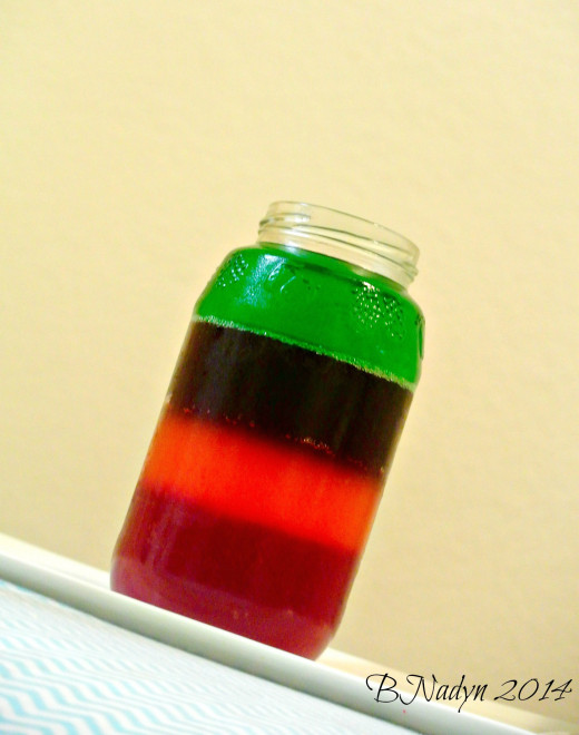 Rainbow Jello in a jar.  Use small jars to serve kids at party.  Start with letting one color of Jello firm at a time, then add another layer of colored Jello.