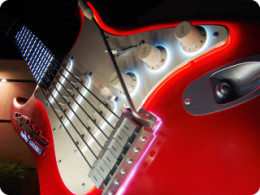 Neon glow emanating from the signature Fender Stratocaster outside of the Rock 'n' Roller Coaster Starring Aerosmith.