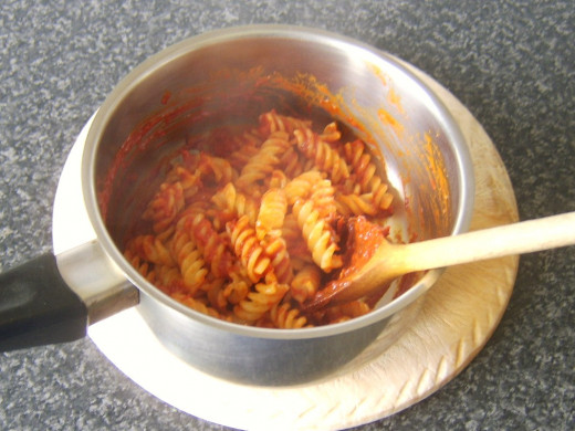 Fusilli pasta is folded through sweet pepper and tomato sauce