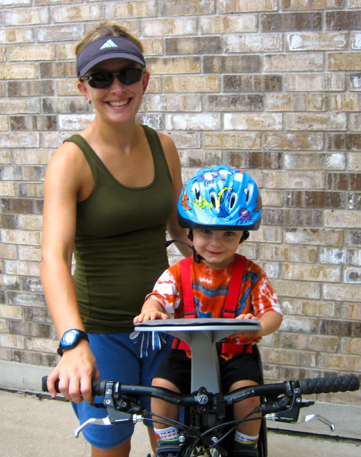 Biking with your kids in a child seat on your  is a great way to exercise and get some fresh air.  Toting the extra kid pounds makes it more challenging!