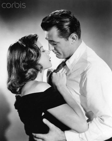 "Olivia de Havilland, left, and Robert Mitchum, two stars of ""Not as a Stranger."""
