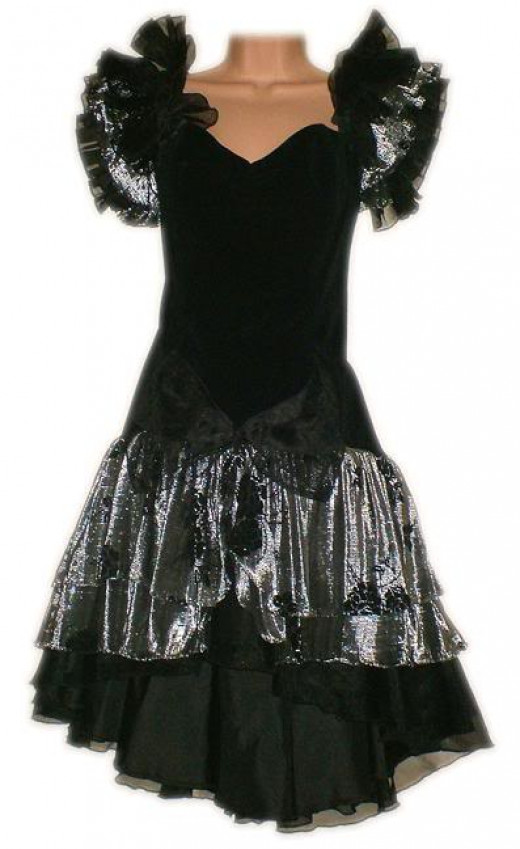 This one would be pretty with a little less poof on the shoulders, a slightly higher neckline and a touch more color