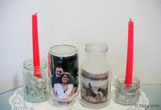 Glass jars can be useful for wedding and party décor including photo frames, candle holders, table numbers and flowers.