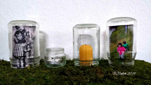 Glass jars make it easier to change out photos and takes up less space than picture frames.
