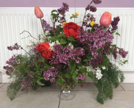 Lilac, fennel and tulips in a cottage garden floral arrangement