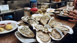Above in the photo are raw oysters on the half shell which are so delicious. Serve hot sauce, fresh lemon slices and saltine crackers to go with the raw oysters on the half shell.