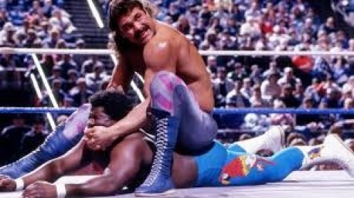 Ravishing Rick Rude is seen here putting the moves on CoCo Beware.