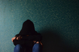 Public domain picture of a depressed man in a hoodie, feeling the isolation.