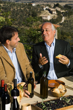 The older man (right) is tipsy from drinking, but he is the wealthy client, so no one will rebuke his foolish behavior.