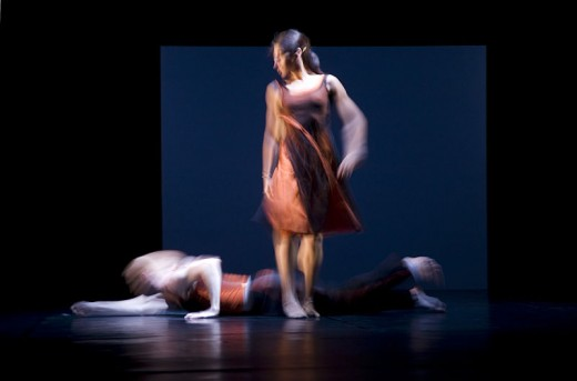 Jorge Royan, Two dancers captured in blurred movement in a modern ballet production.