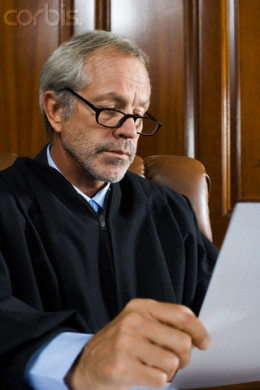 a judge looks over a legal brief.