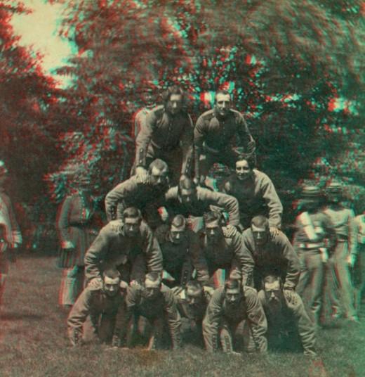 Enthusiastic militiamen form a human pyramid