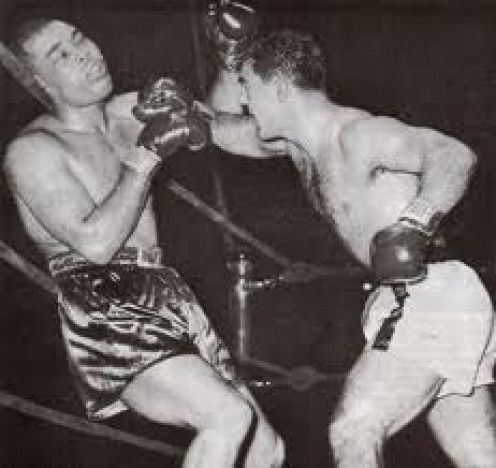 Rocky Marciano knocked down Joe Louis twice in the eighth the second time through the ropes.