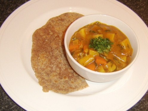 Indian paratha served with vegetable curry