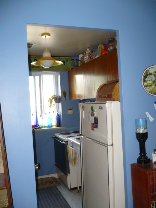 The kitchen is a gally kitchen so was hard to photograph it. I painted the whole kitchen blue. I also painted the outside hallway walls of the kitchen blue to keep your eye trained on the blue theme.