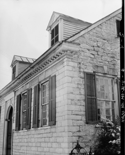 """A 1934 photograph showing details of a window and a cornice of the Felix Valleé House in Ste. Geneviève, Missouri. It was built by Samuel Phillipson, an early settler, and in 1823 it was sold to Felix Vallé. The house is now maintained as a museum"""