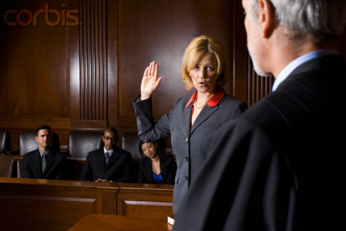 A witness is sworn-in to testify for either the prosecution or defense.