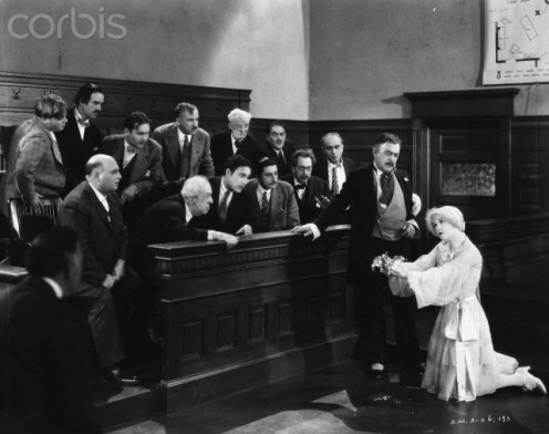 "Roxy Hart, right, played by Phyllis Havel, begs the jury for life as her attorney, Flynn looks on. This is a scene from a classic film, ""Chicago 1927."""