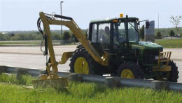 Boom arm mower-used to trim roadsides and trees along roadsides.