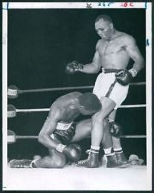Jersey Joe Walcott knocked out Ezzard Charles in their third meeting to become the heavyweight champion of the world.