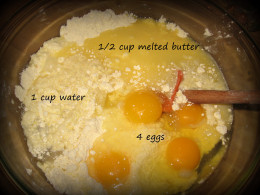 3. Add the wet ingredients (eggs, melted butter, water) into the dry.
