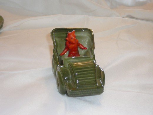"Devil driving a car. 4 1/2"" x 2 1/2"". Paid $33."