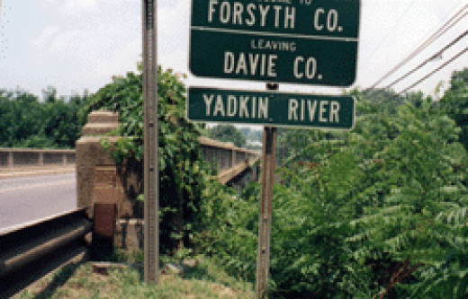 The Yadkin River sign in Davie County, North Carolina. Photo Image taken by the author on a July 2000 visit to the area.