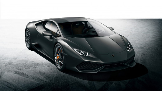 Front view of a black (with Orange brake calipers) Lamborghini Huracan