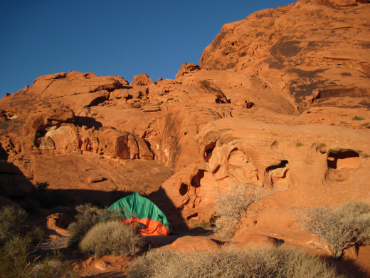 That's our little 2-person tent nestled among the gorgeous red sandstone caves, right near a beautiful canyon we hiked.