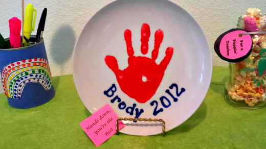 A plate with a child's hand print is a wonderful way to show the teacher you appreciate their helping hand in your child's education.