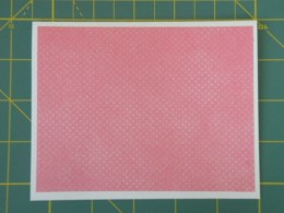 Pink dotted background layer adhered to card
