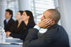 The salesman is simply bored out of skull at some boring sales conference