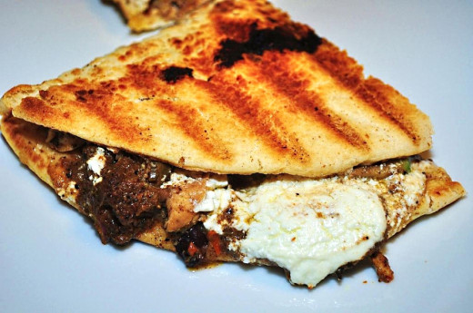 Jerk chicken Jamaican style is often served in a folded flat bread from road side stalls