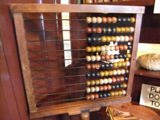 "The use of a ""counting machine"" or abacus has been pervasive in many cultures throughout the ages. This is an example of an 18th Century English model."