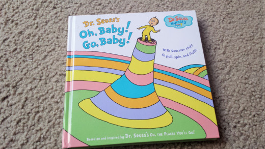 "Dr. Seuss, ""Oh Baby, Go Baby,"" is a cute board book that your tot can read this week.  It contains interactive things inside, perfect for the curious readers!"