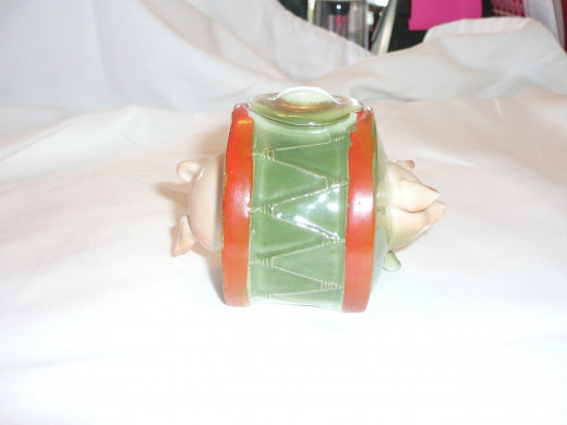 "This is a drummer pig bank. Featured in ""This little Piggy"" its '92 price was $210. 4"" x 3"". Paid $61. Common."