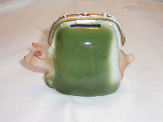 "This piggy is caught in a money purse. Featured in ""This little Piggy"" its '92 price was $60. 4"" x 3"". $12 Common"