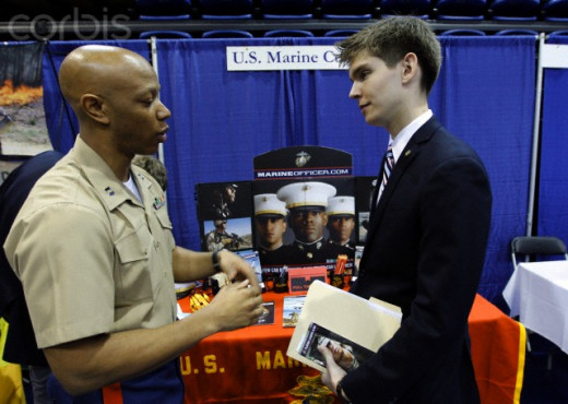 The Marine Corps recruiter, left, discusses jobs for vets after their military service is over with a student from American University