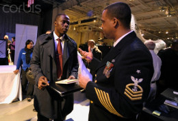 A United States Naval recruiter talks to a possible enlistee