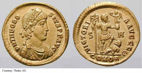 Theodosius I standing right, stepping on captive, holding labarum and Victory on globe. 393-395 (Sirmium).