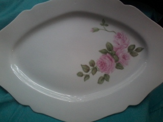 Hand painted pink roses on a white porcelain platter. Simple, beautiful and useable.