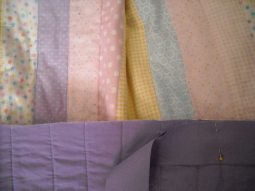 See how the raw edges of the binding are matched with the raw edges of the quilt?
