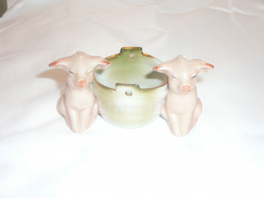 "Two pigs by a bucket.  Featured in ""This little Piggy"" its 1992 value was $45. There is also a more rare edition with bears also valued at $80 but I wouldn't be surprised if it got more. $3 1/4"" x 1 1/4"". Paid $45 Common"