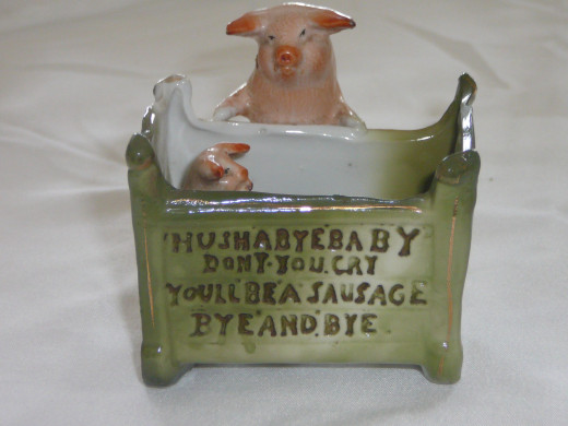 "Hushabye baby don't you cry you'll be a sausage bye and bye. Featured in ""This little Piggy"" its '92 value was $190. 2 3/4"" x 3"". $67 Common."