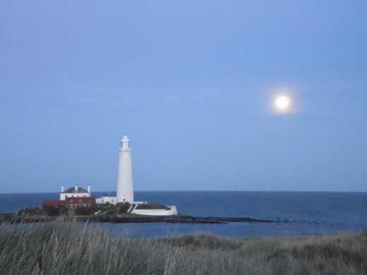 The Moon rising behind St Mary's Lighthouse, Northumberland