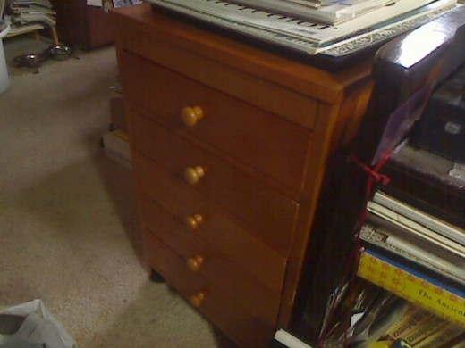 Americana Taboret next to my laptop cart, with drawer knobs and casters added. It rolls so easy on carpet, it's great!