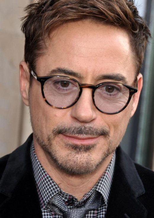 Robert Downey Jr (2013)- Looking pleased. Probably due to the sum of money he is currently earning.