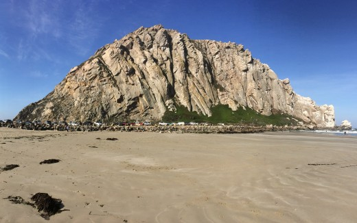 An up-close view of Morro Rock on the beach.